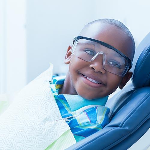 smiling boy waiting for dental exam
