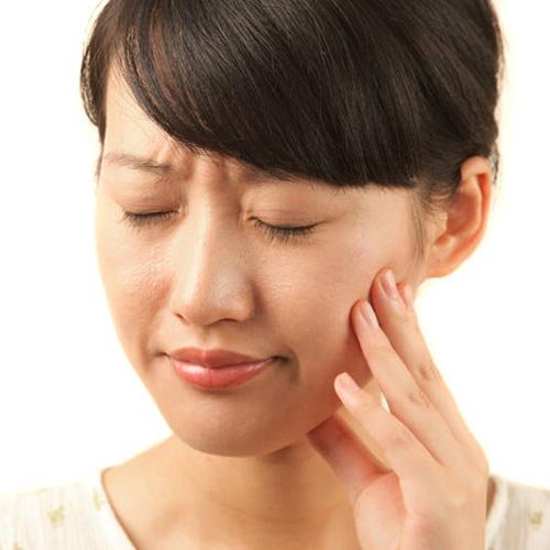 woman tooth pain hold mouth cheek